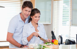 Married couple cooking Stock Images