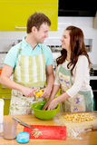 Married couple cooking apple pie at the kitchen at home Stock Photos