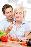 Married couple cooking breakfast together Stock Photos