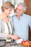 Married couple cooking a meal Royalty Free Stock Photo