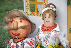 A married couple in costumes Stock Images