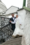 Married couple descending old stone stairway Royalty Free Stock Photo