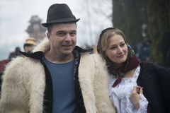 Married couple dressed in traditional Romanian clothes_ Stock Photos