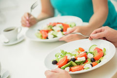 Married couple eating fresh salad Royalty Free Stock Photos