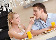 Married couple eats in the kitchen Royalty Free Stock Images