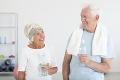 Married couple at the gym. Married couple of elders holding water bottles at the gym Stock Images