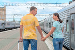 Married couple embarks on a journey on the train Stock Photography
