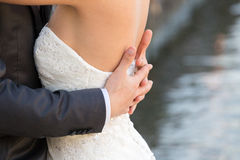Married couple embraced, detail of the bust and arms Royalty Free Stock Image
