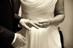 Married couple. Exchanging of the wedding rings Stock Photo