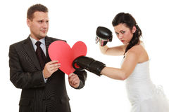 Married couple fighting. Bad relationship conflict. Married couple fighting. Wife showing her husband who's boss. Angry women bride in wedding dress boxing Stock Images