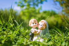 Married couple figurine of bride and groom on grass Stock Photo
