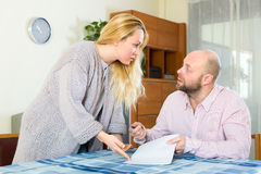 Married couple filling in forms stock photo