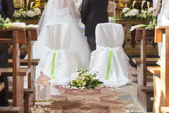Married couple in front of the church altar Royalty Free Stock Image