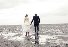 Married couple goes for a walk in the Wadden Stock Images