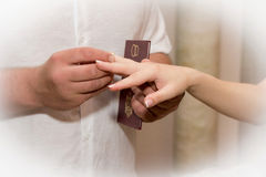 Married couple. Groom puts wedding ring on bride's finger Royalty Free Stock Photo