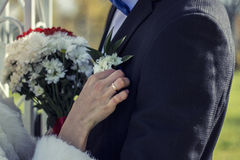 The married couple, hands and fingers with rings, flowers Royalty Free Stock Photo