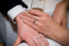 Married Couple Hands With Glass of Champagne Stock Photo