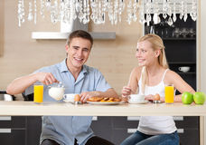 Married couple has a snack in the kitchen Royalty Free Stock Photos