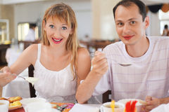 Married couple having breakfast at restaurant Royalty Free Stock Images