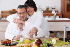 Married couple having breakfast Stock Images