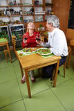 Married couple having diner Stock Images