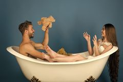 Married couple having fun. Boyfriend and girlfriend relax on blue background Royalty Free Stock Image