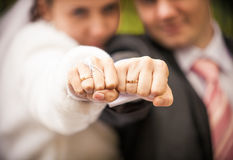 Married couple holding closed fists with wedding rings Stock Photo