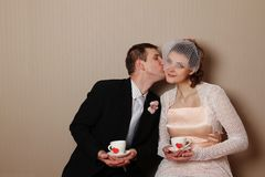 Married couple holding a cup with hearts Stock Photos