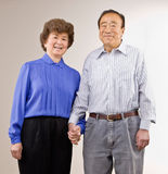 Married couple holding hands Stock Images