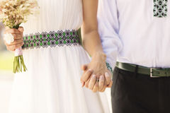Married couple holding by hands Stock Photo