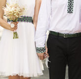 Married couple holding by hands Stock Image