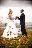 Married couple holding hands at autumn windy day Royalty Free Stock Photo