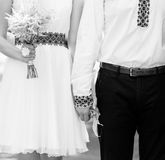 Married couple holding by hands, black and white photo Royalty Free Stock Images