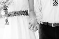 Married couple holding by hands, black and white photo Stock Photography