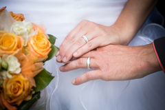 Married couple holding hands, ceremony wedding day Stock Images