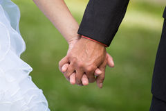 Married couple holding hands, ceremony wedding day Royalty Free Stock Photography