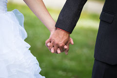 Married couple holding hands, ceremony wedding day Royalty Free Stock Photos