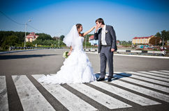 Married couple holding hands and on crosswalk Royalty Free Stock Images
