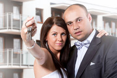 Married couple holding keys to new home Royalty Free Stock Photo