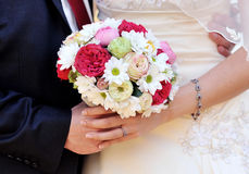 Wedding hands with flowers Royalty Free Stock Photo