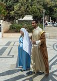 A married couple - husband and pregnant wife in the clothes of JA married couple - husband and pregnant wife in the clothes of Jes. Nazareth, Israel, December 23 stock image