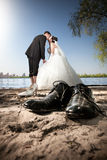 Married couple kissing on beach Stock Photo