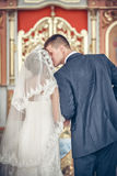 Married couple kissing in a church Royalty Free Stock Photography