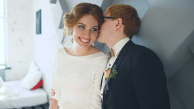 Married couple kissing and smiles each other before wedding ceremony stock footage