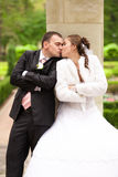 Married couple kissing under column Royalty Free Stock Photography
