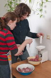 Married couple on kitchen. stock photography