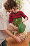 Married couple on kitchen. stock photos