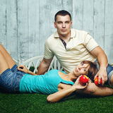 Married couple on the lawn Stock Photography