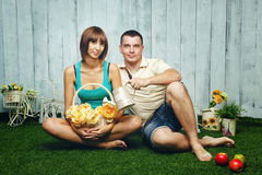 Married couple on the lawn. Young, happy married couple relaxing on the lawn and enjoys Royalty Free Stock Photos