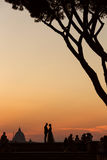 Married couple in love on Rome at sunset with Saint Peter's Basi Royalty Free Stock Photography